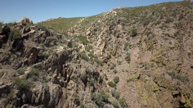 A drone descends donw a mountain face near Julian California