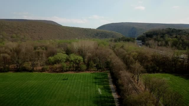 a drone descends on a soccer field near the delaware water gap in pennsylvania - dronebase stock videos and b-roll footage