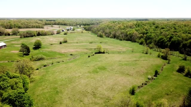 a drone descends onto the farm countryside of napoleon indiana - indiana stock videos & royalty-free footage