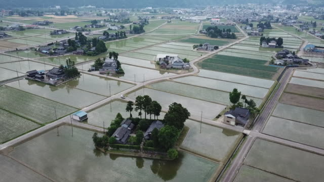 drone: dispersed settlement in toyama, japan - toyama prefecture stock videos and b-roll footage