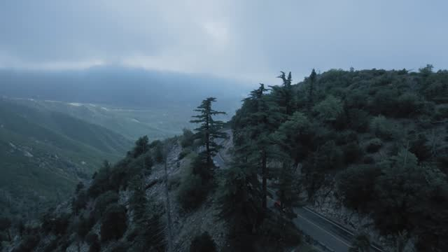 a drone filming the road and cars, aerial view on the top of the mountain near twin peaks, california, usa - western usa stock videos & royalty-free footage
