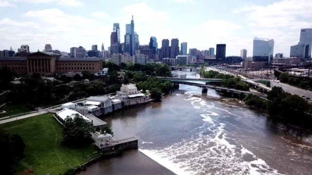 a drone flies above schuylkill river in philadelphia pennsylvania - center city philadelphia stock videos and b-roll footage