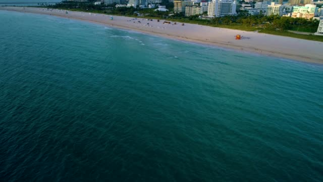 a drone flies above south miami beach florida - フロリダ州点の映像素材/bロール