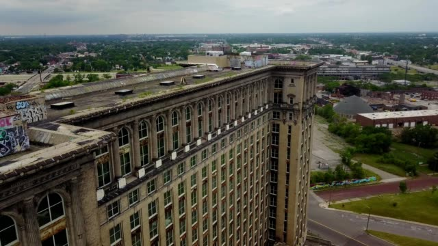 a drone flies above the abandoned central train station in detroit michigan - detroit michigan stock videos & royalty-free footage