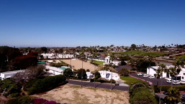 a drone flies above the city of encinitas california - dronebase stock videos and b-roll footage