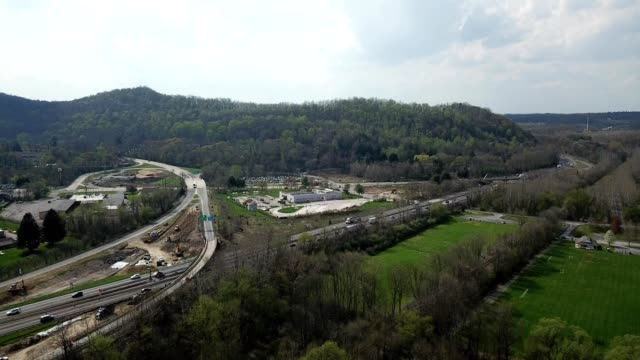 a drone flies along an interstate between pocono mountains in delaware water gap pennsylvania - dronebase stock videos and b-roll footage