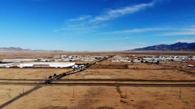 a drone flies along highway 66 by sitting aircraft in kingman arizona - kingman arizona stock videos & royalty-free footage