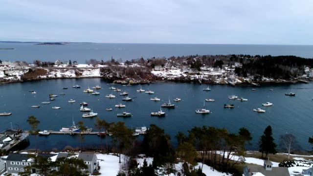 a drone flies along mackerel cove on bailey's island in harpswell maine - dronebase stock videos and b-roll footage