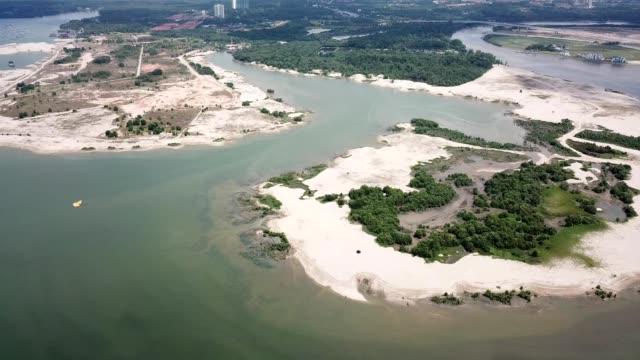 a drone flies along man made islands at johor bahru danga bay in malaysia - johor stock videos & royalty-free footage