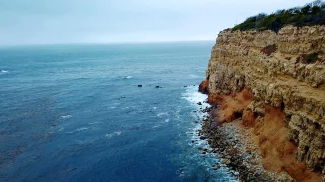 a drone flies along the cliffs bleow point vicente in rancho palos verdes california - palos verdes stock videos & royalty-free footage