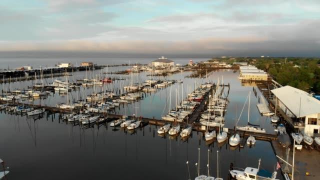 A drone flies around Lake Pontchartrain yacht club in New Orleans Louisiana