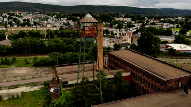 a drone flies around old murry's holding complex and smoke stack in wilkes-barre pennsylvania - wilkes barre stock videos & royalty-free footage