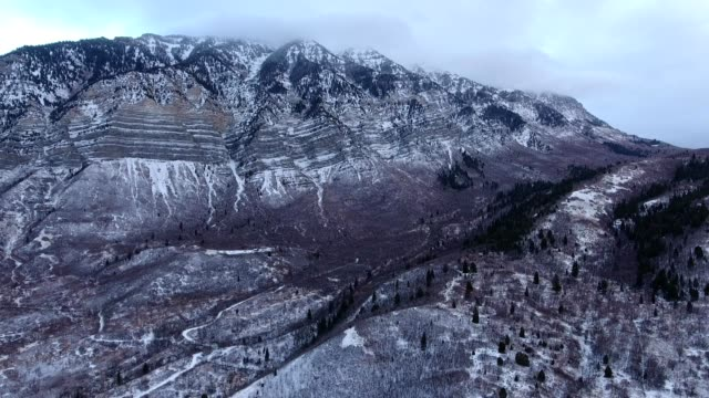 a drone flies at a rocky mountain before a snow storm in provo utah - provo stock videos & royalty-free footage