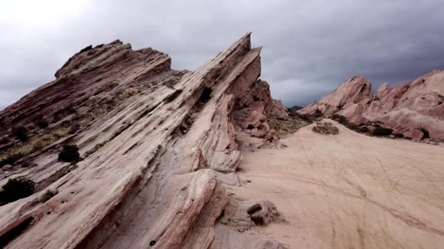 a drone flies atop vasquez rocks during a light rain in agua dulce california - vasquez rocks stock videos and b-roll footage