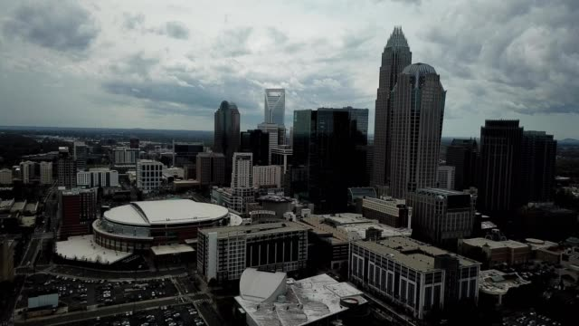 a drone flies away from downtown charlotte north carolina - charlotte north carolina stock videos & royalty-free footage