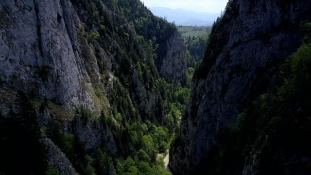 A drone flies between mountains of the Zărnești gorge in Brașov County Romania