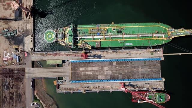 a drone flies birdseye over a docked oil tanker in pasir gudang johor malaysia - johor stock videos & royalty-free footage
