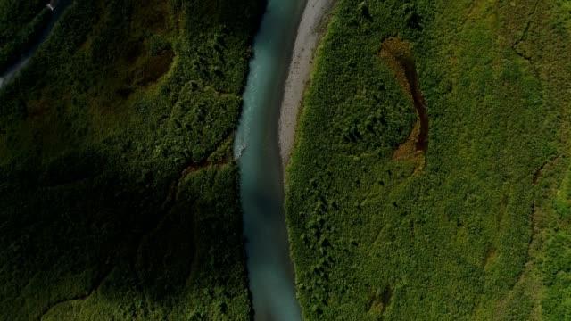 a drone flies birdseye over a glacier fed river in portage alaska - anchorage alaska stock videos and b-roll footage