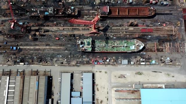 a drone flies birdseye over a shipyard in pasir gudang johor malaysia - johor stock videos & royalty-free footage