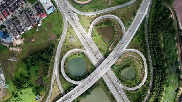 a drone flies birdseye over an expressway intersection in johor bahru malaysia - johor stock videos & royalty-free footage