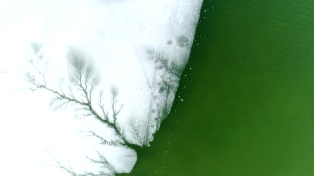 a drone flies birdseye over an icy coast in mukwonago wisconsin - dronebase stock videos and b-roll footage