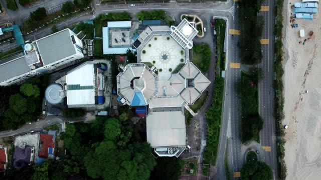 a drone flies birdseye over an islamic complex in johor bahru malaysia - johor stock videos & royalty-free footage