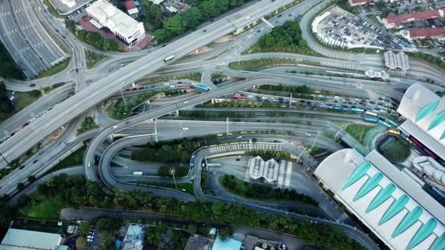 a drone flies birdseye over immagration customs complex in johor bahru malaysia - johor stock videos & royalty-free footage