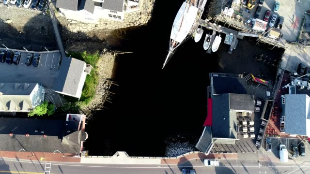 a drone flies birdseye over kennebunkport's main bridge in maine - maine stock videos & royalty-free footage
