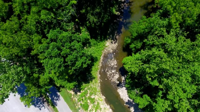 a drone flies birdseye over little mill creek in shawnee kansas - kansas stock videos & royalty-free footage