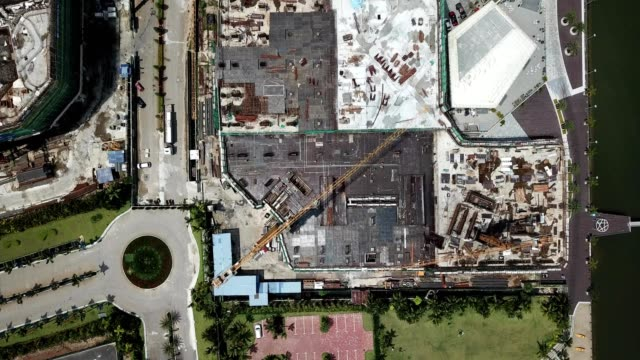 a drone flies birdseye over the construction of a condominium at johor bahru danga bay in malaysia - johor stock videos & royalty-free footage
