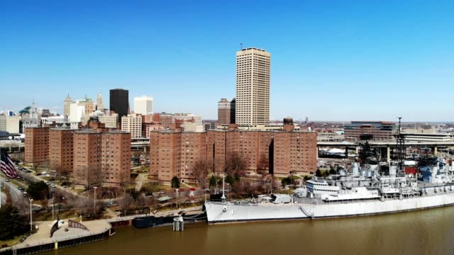 a drone flies by a battleship on the canal of buffalo new york - buffalo new york state stock videos & royalty-free footage