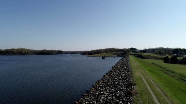 a drone flies by a lake in high point north carolina - high point video stock e b–roll