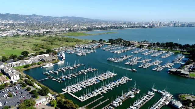 A drone flies by a marina in the San Francisco Bay of Berkeley California