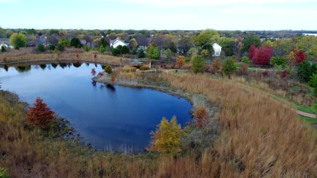 a drone flies by a small pond and gazebo in vernon hills illinois - gazebo stock videos & royalty-free footage