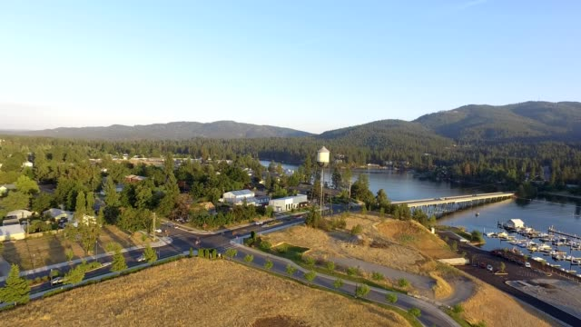 a drone flies by a water tower in post falls idaho - idaho stock videos & royalty-free footage