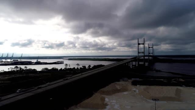 a drone flies by dames point bridge in jacksonville florida - jacksonville florida video stock e b–roll