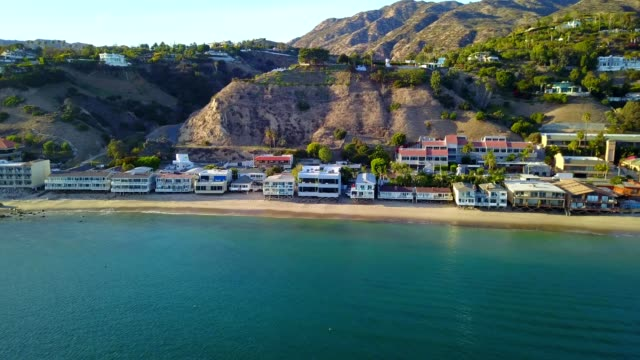 a drone flies by mansions on the coast of malibu california - malibu stock videos & royalty-free footage