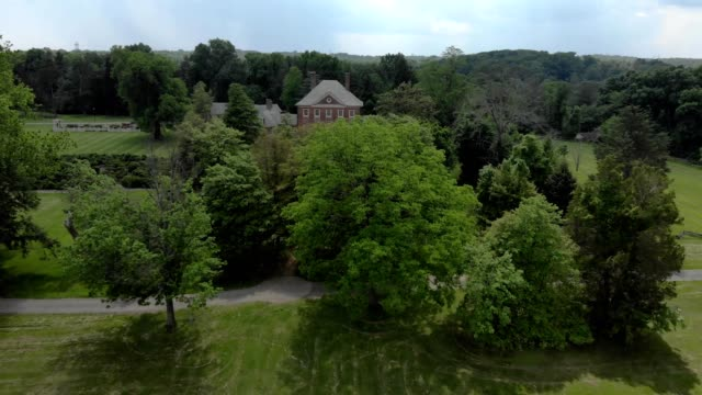 a drone flies by montpelier mansion in laurel maryland - laurel maryland stock videos & royalty-free footage