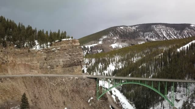 A drone flies by Red Cliff Bridge in White River National Forest in Colorado