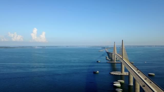 a drone flies by the sunshine skyway bridge in tampa florida - tampa stock videos & royalty-free footage