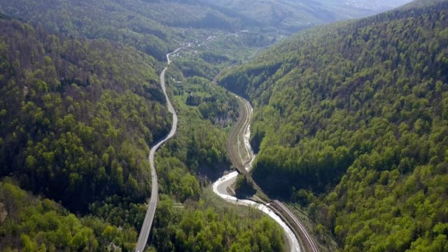 a drone flies downstream along posada valley in prahova county romania - トランシルバニア点の映像素材/bロール