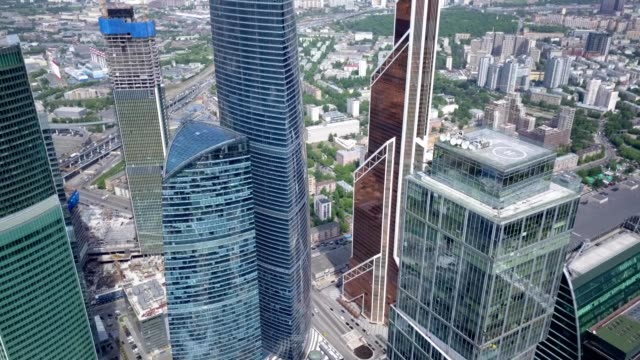 a drone flies high in the skyscrapers of moscow russia - river moscva stock videos & royalty-free footage