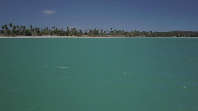 a drone flies in shore towards boqueron beach in cabo rojo puerto rico - ultra high definition television stock videos & royalty-free footage