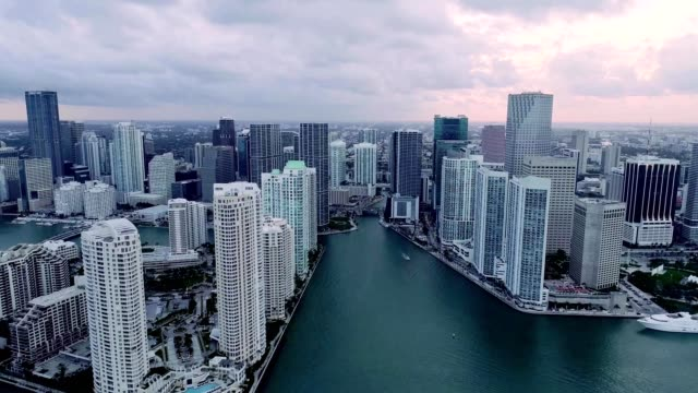 A Drone flies into a cloudly Downtown Miami Florida