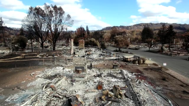 A Drone flies low over Tubbs fire damaged residential homes in Santa Rosa California