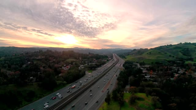 a drone flies near a freeway during sunset in lafayette calfornia - dronebase stock videos and b-roll footage