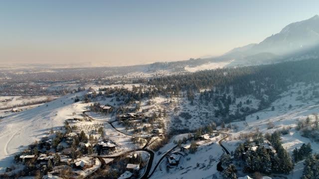 a drone flies near snowy chataqua park in boulder colorado - boulder stock videos & royalty-free footage