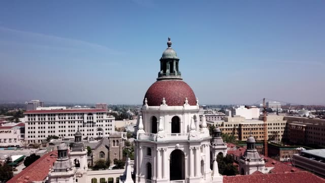a drone flies near the top of pasadena city hall in california - 1927 stock videos & royalty-free footage