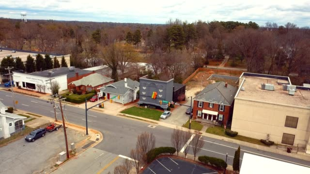 a drone flies over a building shaped like the largest drawers in the world in high point north carolina - high point video stock e b–roll