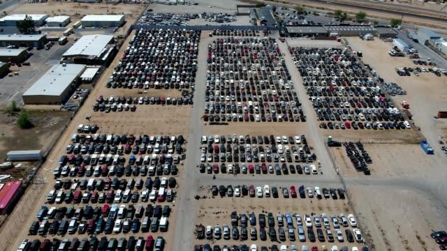 a drone flies over a car graveyard in hesperia california - junkyard stock videos and b-roll footage